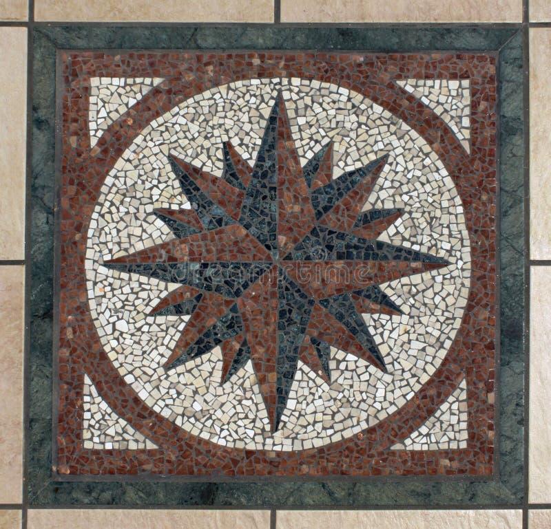 Compas de mosaïque photos stock
