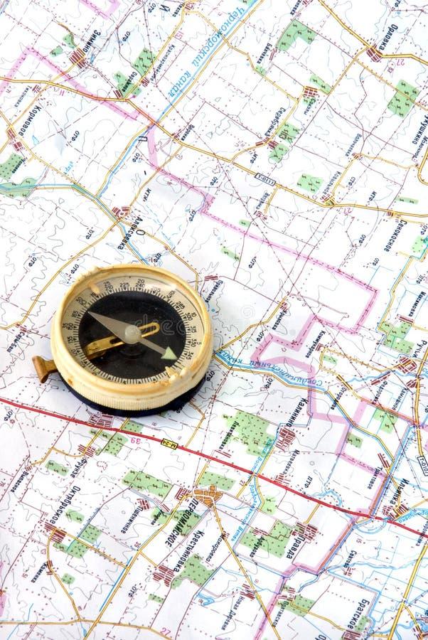 Compas en kaart stock foto's