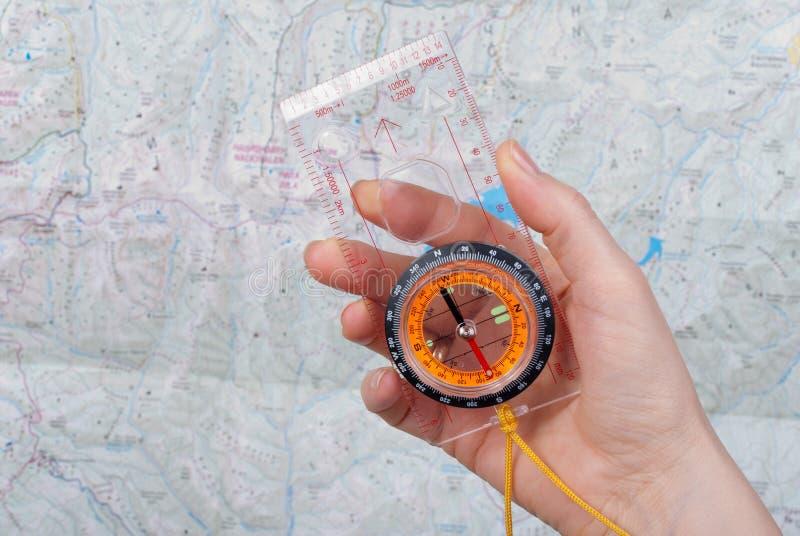 Compas, kaart en hand stock foto's