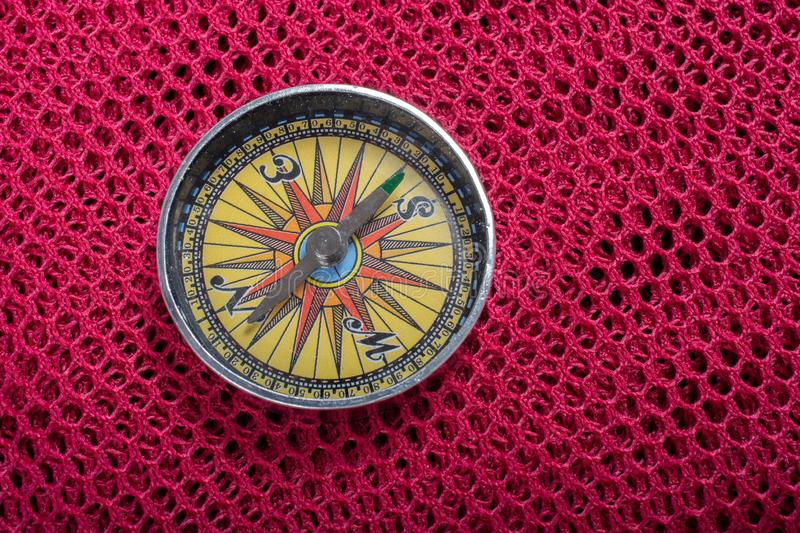 Compass  as a concept of traveling and finding your life. Magnetic compass tool as a concept of traveling royalty free stock photos