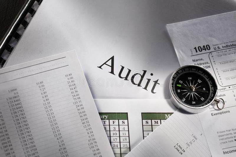 Compass and audit stock photo