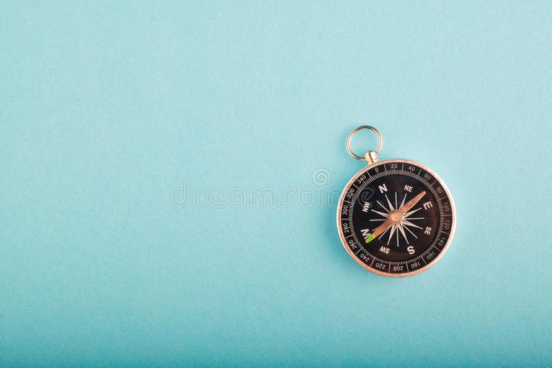 compass on blue background for travel or direction concept royalty free stock photo
