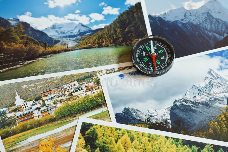 Compass on blur nature photograph of popular tourist destination in autumn background, China traveling concept. Compass on blur colorful nature photograph of royalty free stock photo