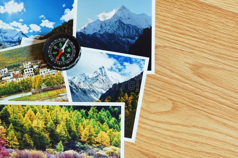 Compass on blur nature photograph of popular tourist destination in autumn background, China traveling concept. Compass on blur colorful nature photograph of royalty free stock photography