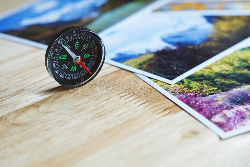 Compass on blur nature photograph of popular tourist destination in autumn background, China traveling concept. Compass on blur colorful nature photograph of stock images