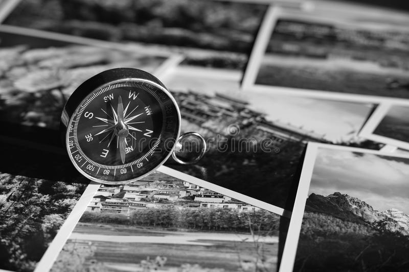 Compass on blur photograph of popular toustist destination background, China traveling concept. Compass on blur colorful photograph of popular toustist royalty free stock photo