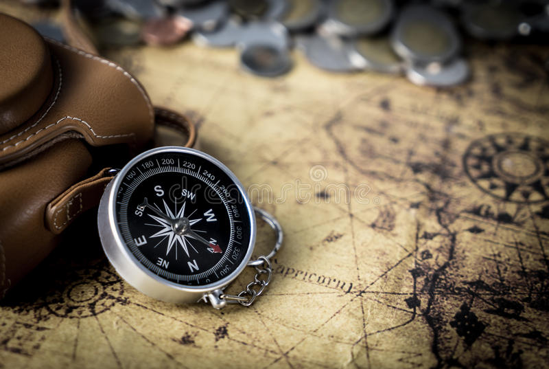 Compass and camera on vintage map royalty free stock photos