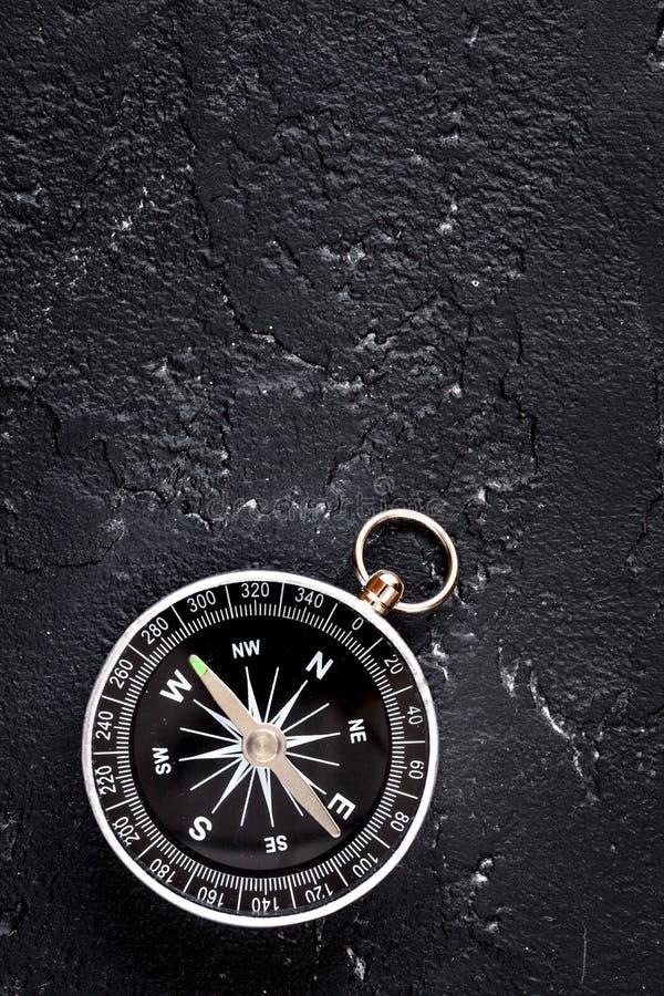 Compass on dark background concept - direction motion top view. Compass on dark background concept direction of motion top view royalty free stock photos
