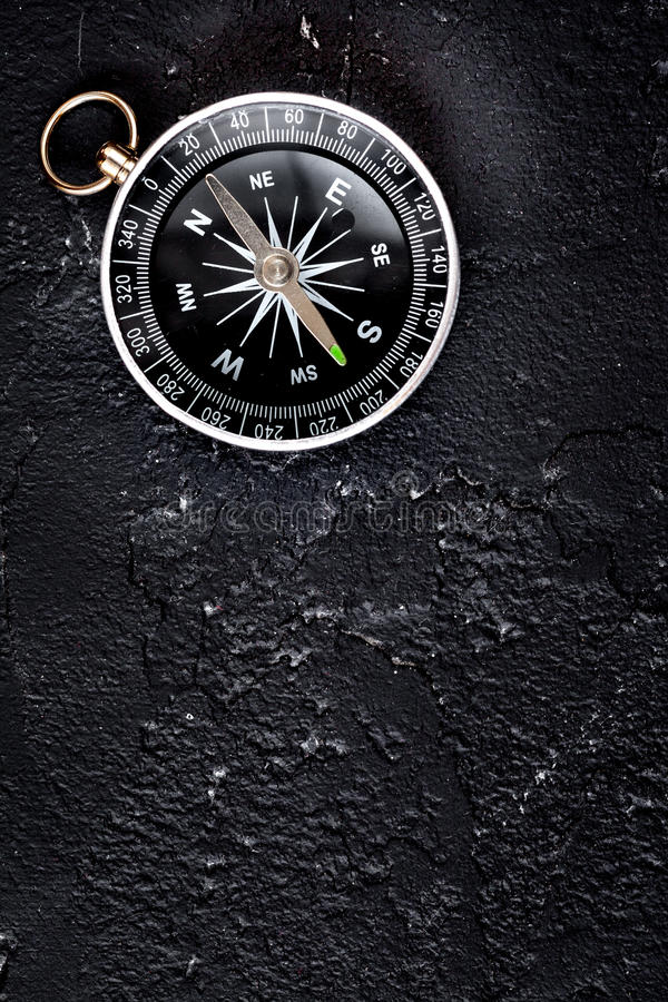 Compass on dark background concept - direction motion top view. Compass on dark background concept direction of motion top view royalty free stock image