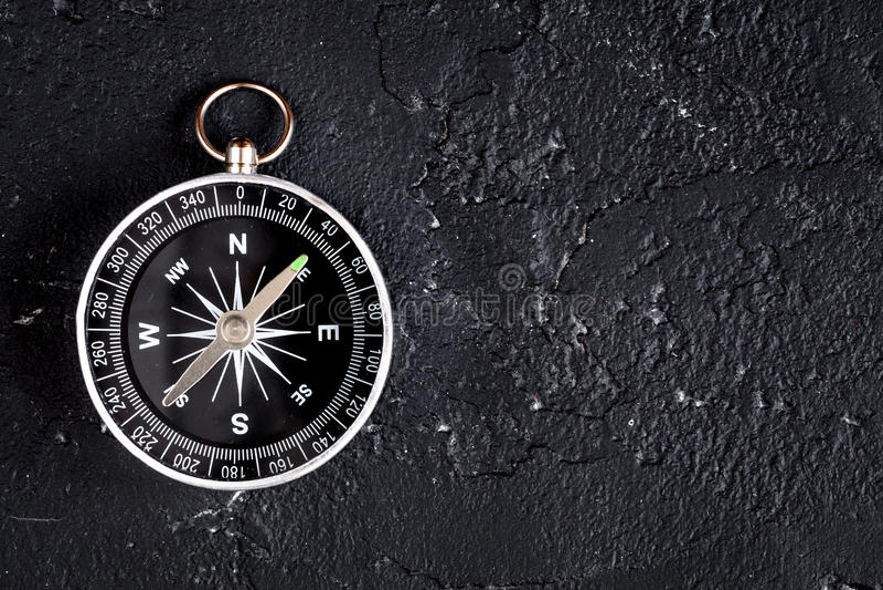 Compass on dark background concept - direction motion top view. Compass on dark background concept direction of motion top view stock photography