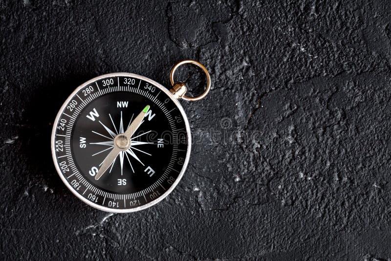 Compass on dark background concept - direction motion top view. Compass on dark background concept direction of motion top view stock photos