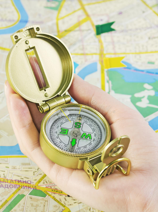 Compass in hand royalty free stock photography