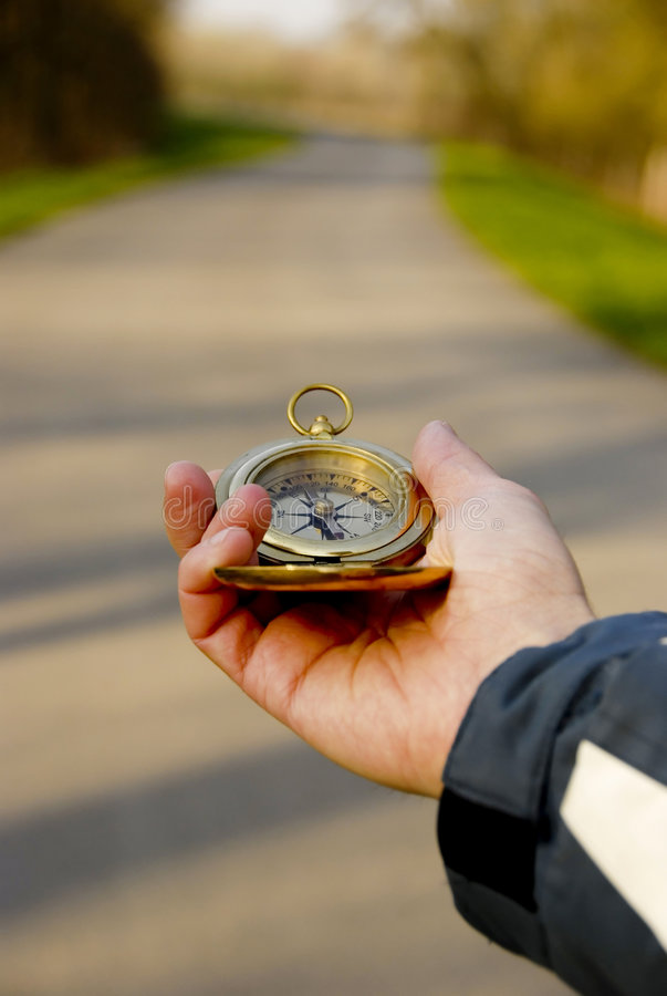 Download Compass in hand stock photo. Image of course, compass - 2208902