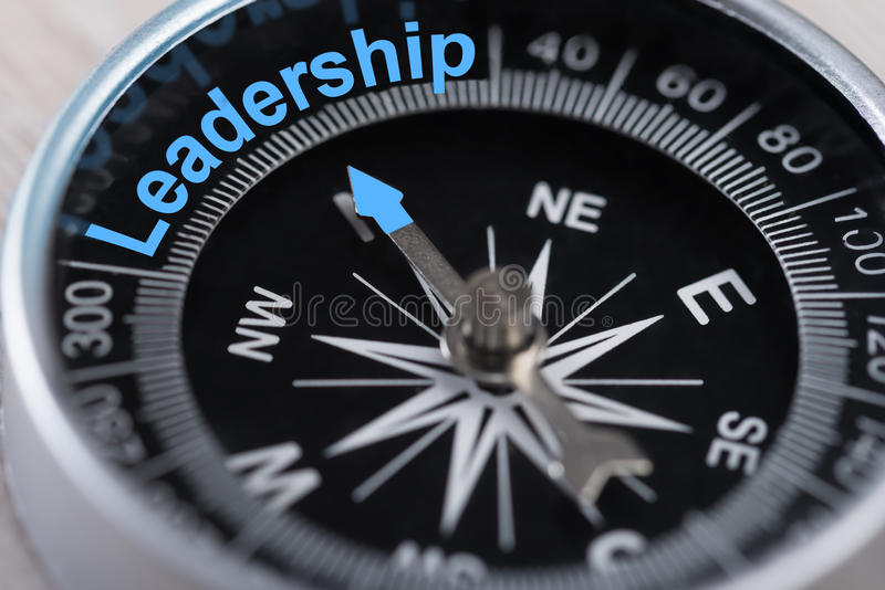 Compass indicating leadership stock images
