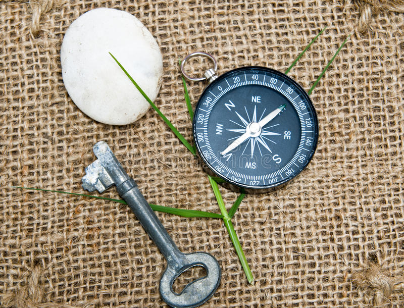 Compass and key. On sack material stock images