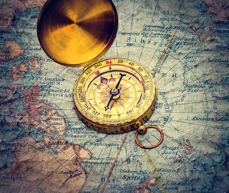 Compass and magnifying glass royalty free stock image