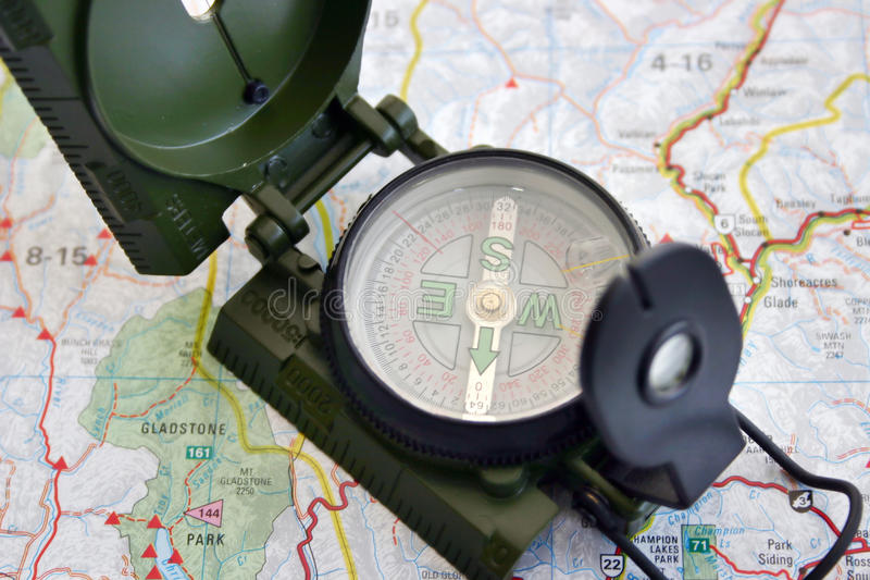 Compass and map. A military compass and map close-up view royalty free stock photography