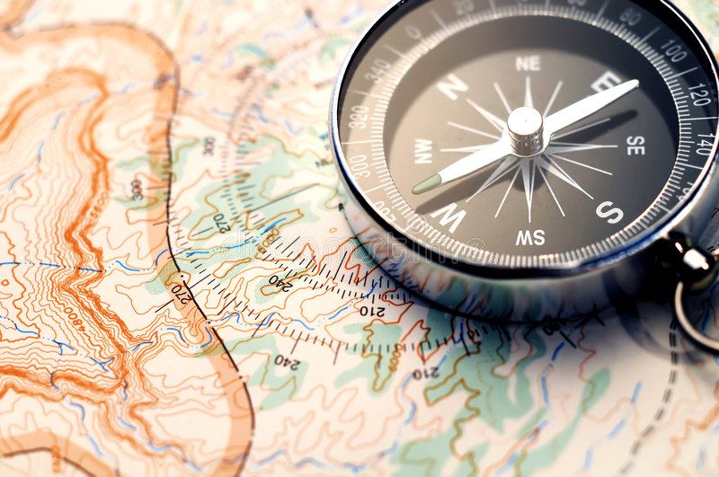 Compass on map stock photo