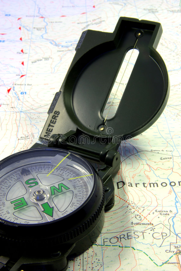 Compass on map. Close up view on a military compass on a map royalty free stock photography