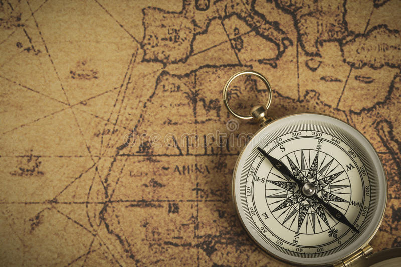 Compass on a map royalty free stock photos