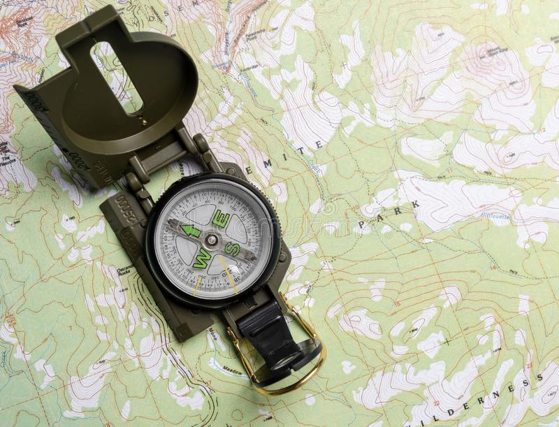 A compass on a map. A compass on a green map, cartography theme. Direction, planning concepe stock photos