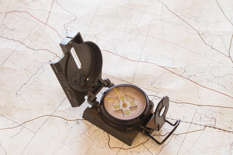Compass and Map. A military type compass on an old topographical map stock photos