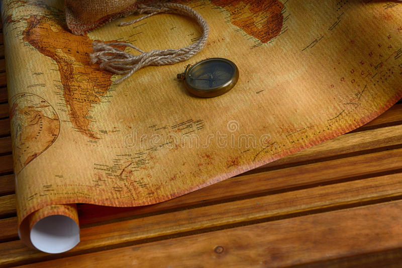 Compass on map. Old compass on vintage map and rope stock photo