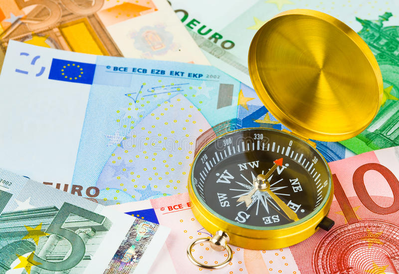 Download Compass and money stock photo. Image of money, magnet - 13295652
