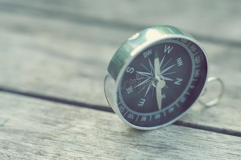 Compass on old wooden table background, journey concept, vintage tone. Compass on old wooden table background, journey planning concept, vintage tone royalty free stock images