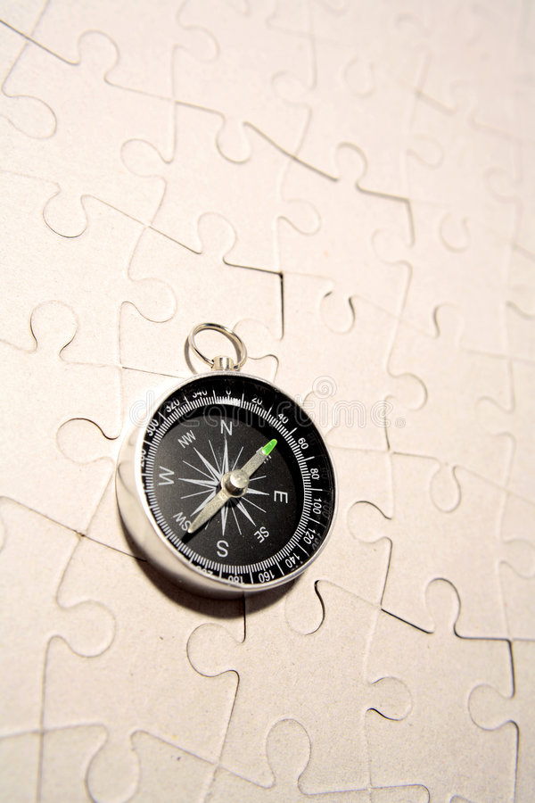 Compass on puzzle royalty free stock photos