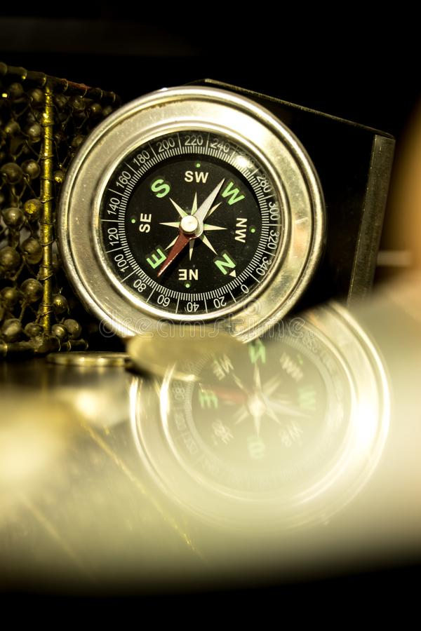 Compass reflection on the foreground. stock photos