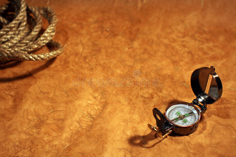 Compass and rope on old paper royalty free stock images