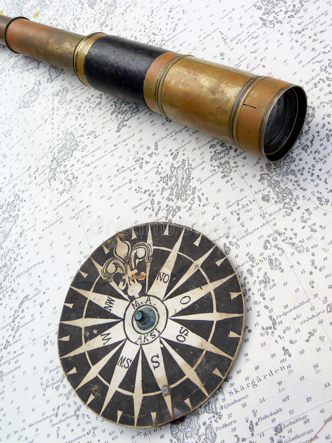 Compass rose and binoculars on map stock images