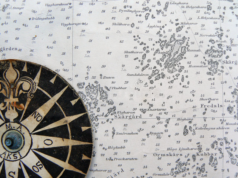 Compass rose on vintage map royalty free stock photo