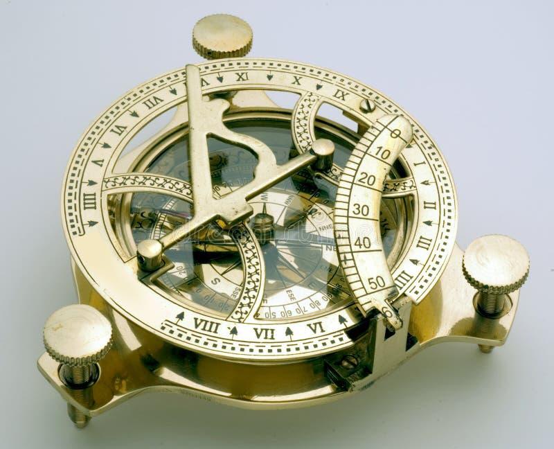 Compass sundial. Brass antique, isolated stock photos