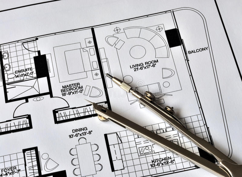A compass on the top of the residence floorplan royalty free stock image