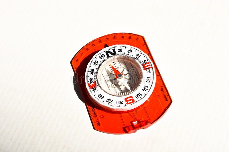 Compass on a white background. Magnetic navigation tool on a clean sheet of paper stock photos