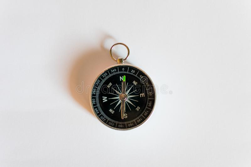 Compass on a white background. Magnetic navigation tool on a clean sheet of paper royalty free stock image