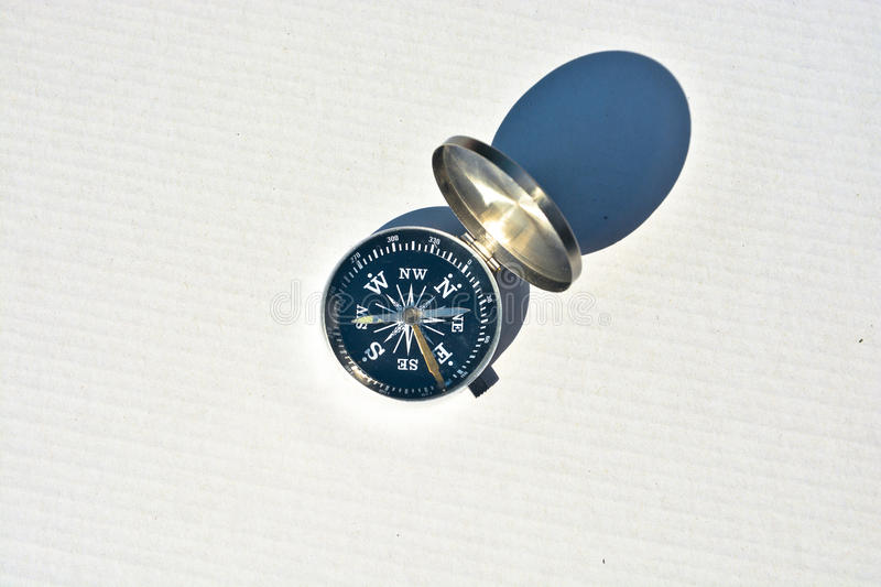 Compass on white. Magnetic navigation tool for orienteering stock photography