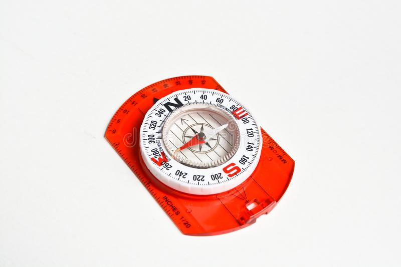 Compass on white. Magnetic navigation tool for orienteering stock image