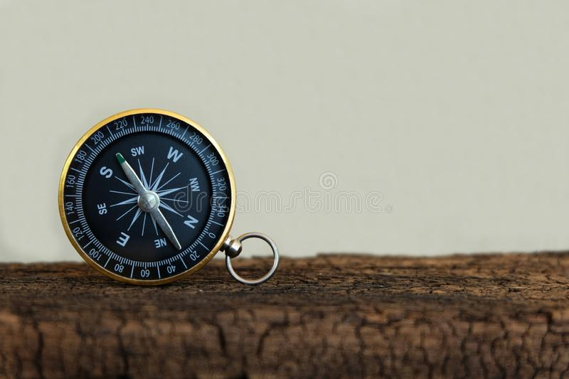 Compass on wooden background, vintage tone, journey planning concept, blank space, top view. Copy space stock photos