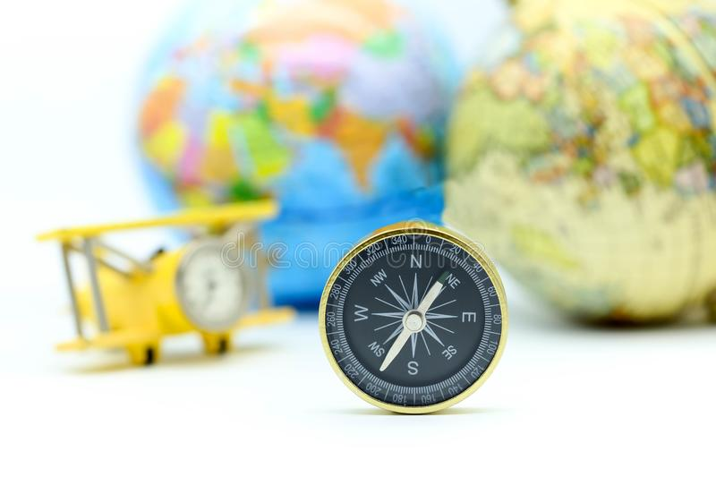 Compass with world map and mini airplane, Adventure stories,Tourist planning vacation concept. stock photography