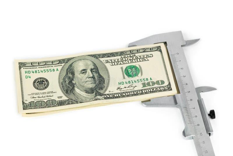 Compasso de calibre e dinheiro fotografia de stock