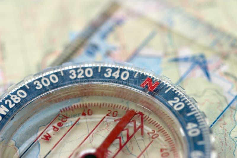 Compasso e mapa, macro fotografia de stock