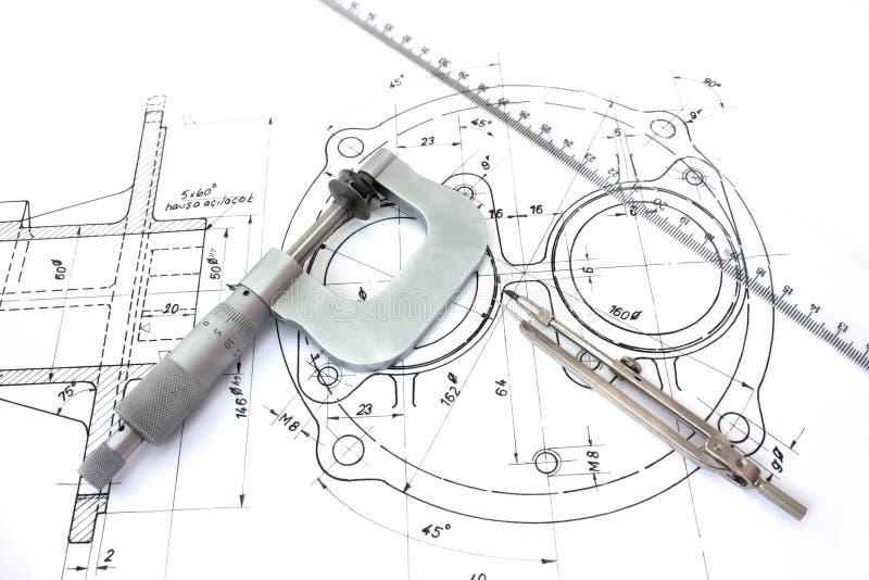 Compasso e régua do micrômetro no modelo foto de stock royalty free