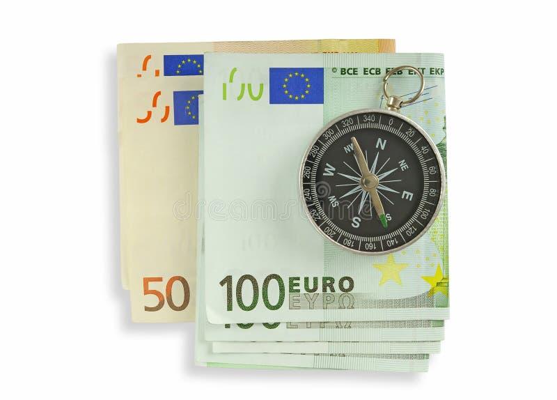 Compasso e um dinheiro. imagens de stock royalty free