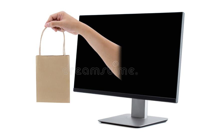 comperando con il monitor LCD della borsa della tenuta della mano isolato fotografie stock