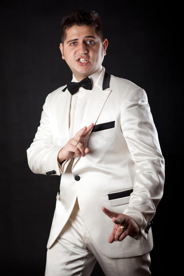 Compere man in an overwhites with a butterfly stock photography