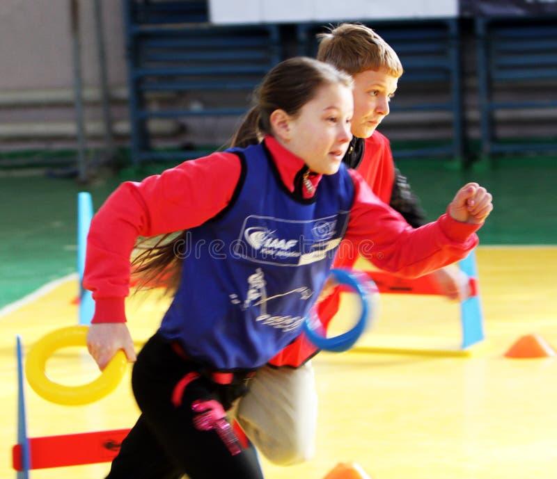 Competencia del atletismo de los niños imagen de archivo libre de regalías