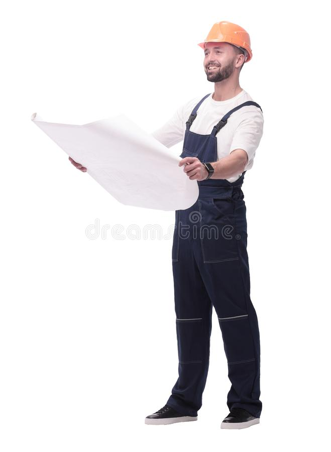 Competent foreman Builder looking at drawings. isolated on white. In full growth. competent foreman Builder looking at drawings. isolated on white background royalty free stock image